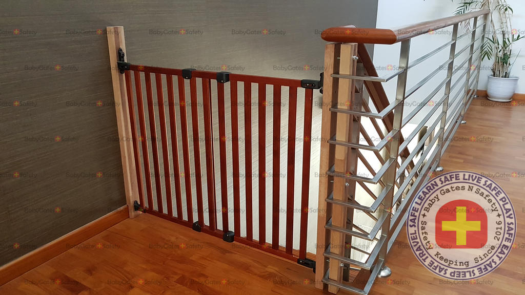 Kidco Wooden Safeway Wall Mounted Gate installed at top of stairs