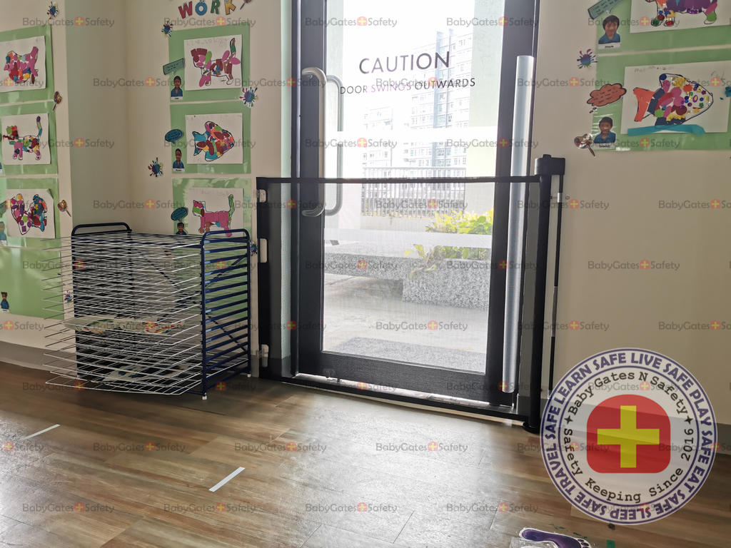 Retractable gate at childcare entrance